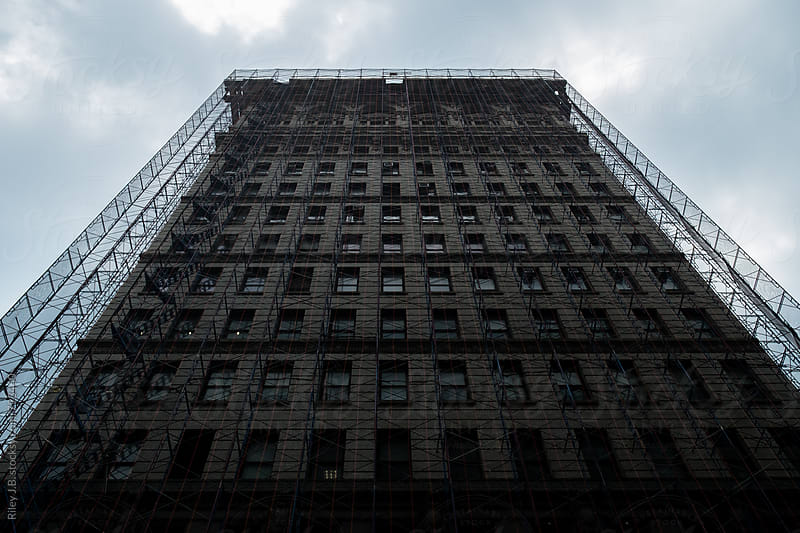 A New York City apartment building with scaffolding by Riley Joseph for Stocksy United