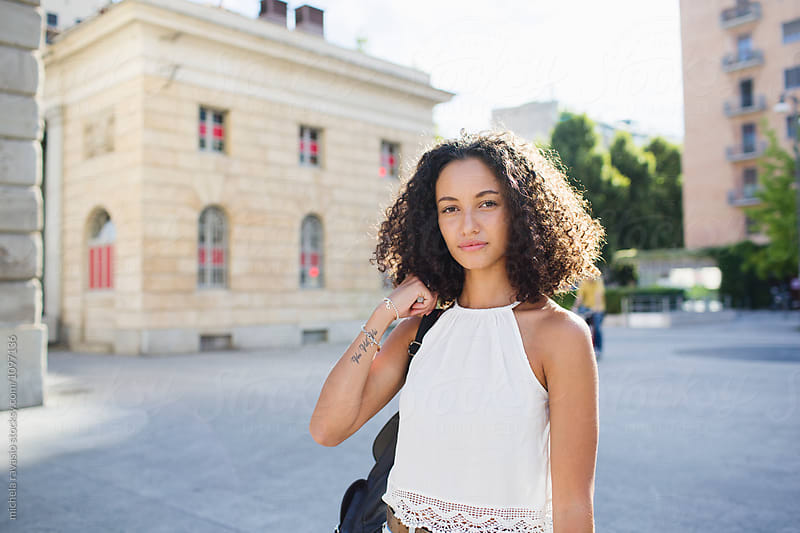 Beautiful curly brunette girl around the city by michela ravasio for Stocksy United
