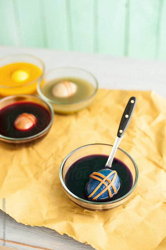 Easter: Dyeing Elastic Band Wrapped Eggs with Vegetable Colors,  by Ina Peters for Stocksy United