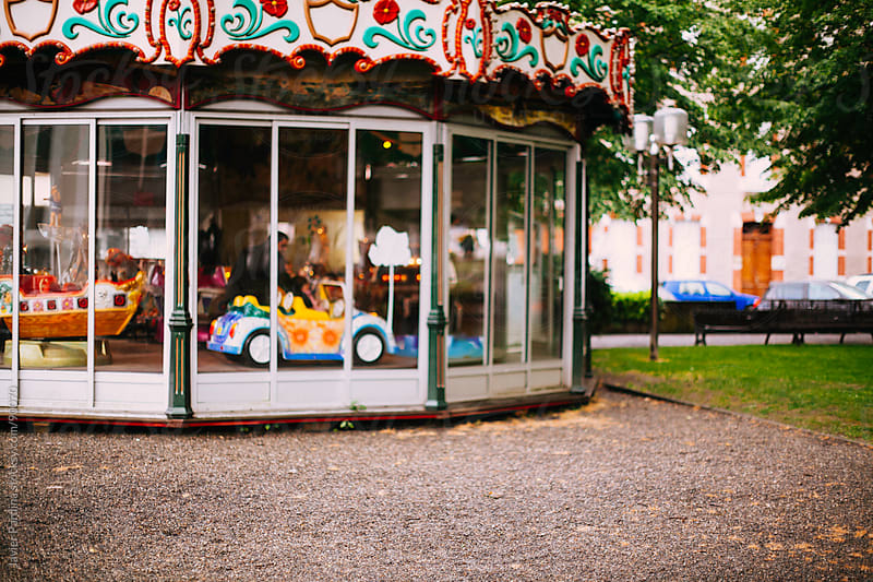 old carousel in the square by Javier Pardina for Stocksy United