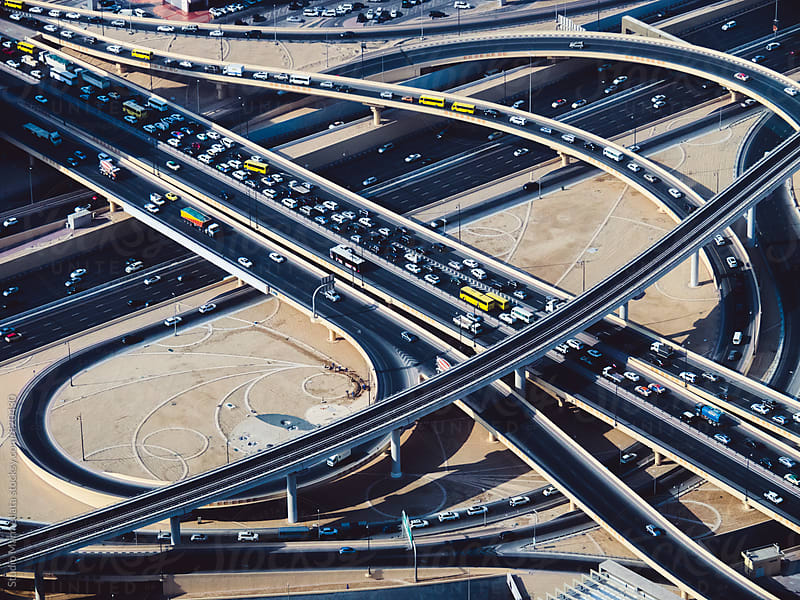 Aerial view of highway road intersections by Juri Pozzi for Stocksy United