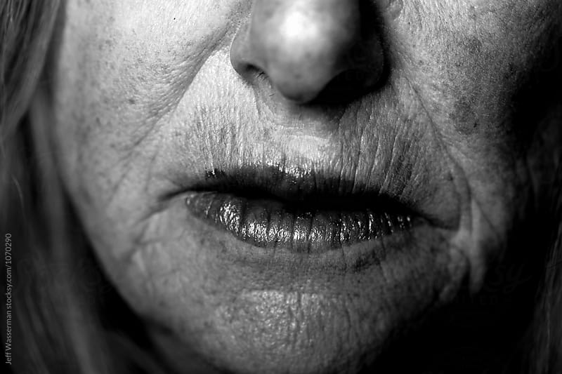 Senior Woman Portrait Mouth in Black and White  by Jeff Wasserman for Stocksy United