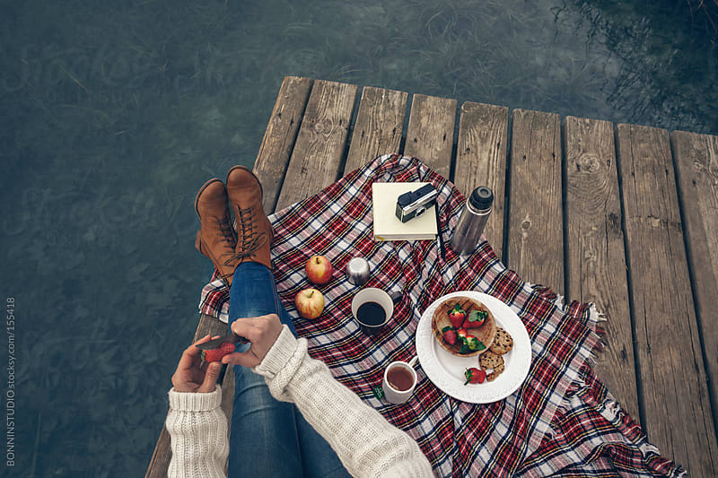 Closeup of woman having picnic breakfast at the lakeshore. by BONNINSTUDIO for Stocksy United