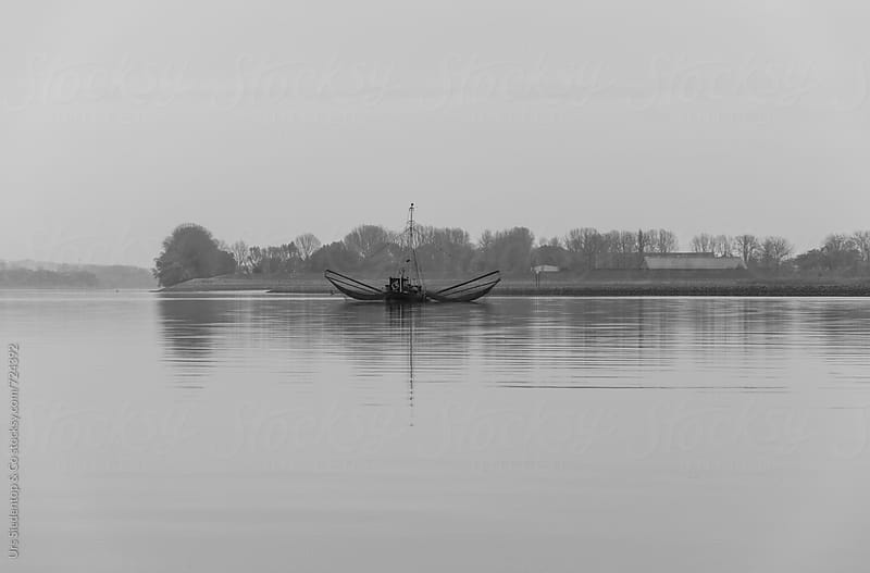 Old wooden fishing boat with two extension arms with trawling nets - black and white image by Urs Siedentop & Co for Stocksy United