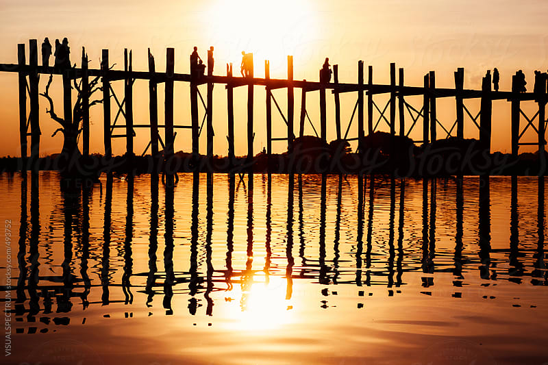Silhouette of People on Long Wooden Bridge in Mandalay, Burma by VISUALSPECTRUM for Stocksy United