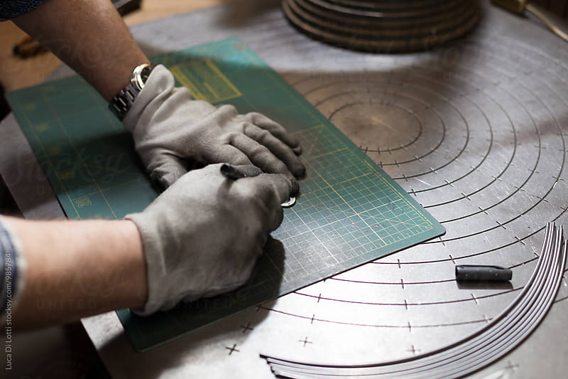 Artisan at Work in his Workshop making lampshades. by Luca Di Lotti for Stocksy United
