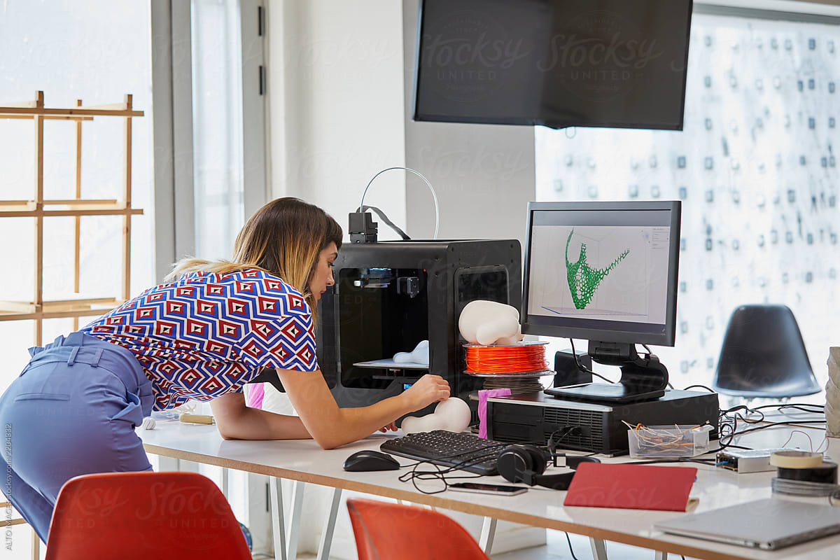 Stock Photo - Young Student Making 3D Model At Desk