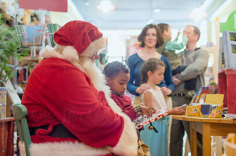 Toddler on Santa's Lap by Brian McEntire for Stocksy United