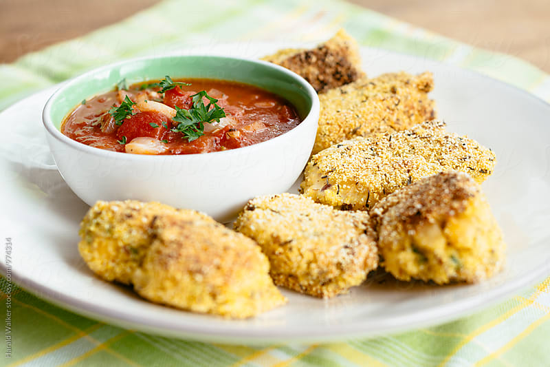 Chickpea nuggets with a marinara sauce by Harald Walker for Stocksy United