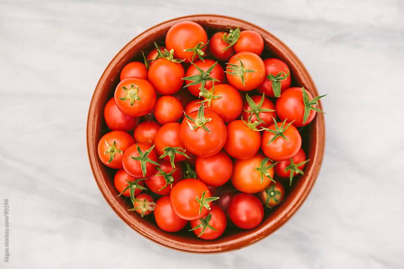 A bowl of freshly picked Tomatoes by kkgas for Stocksy United