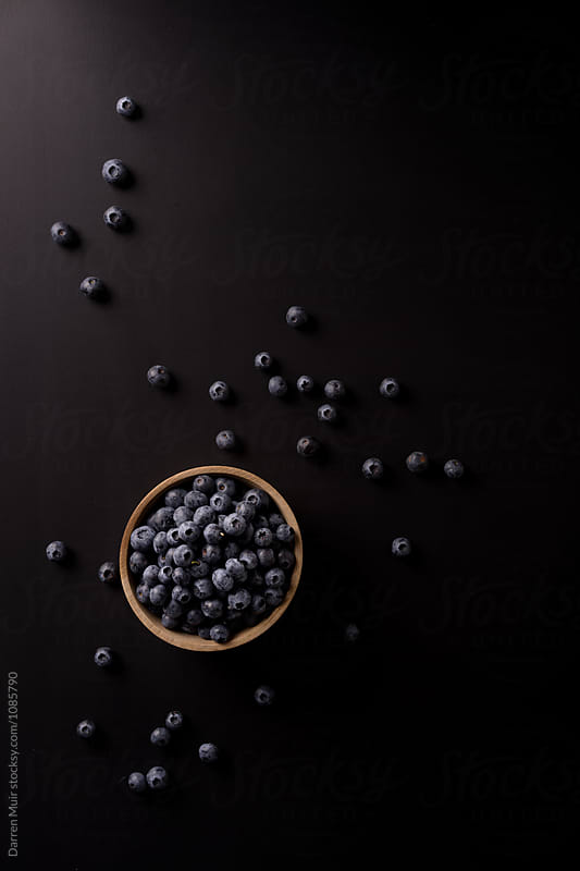 Blueberries on black background. by Darren Muir for Stocksy United