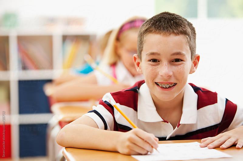Classroom: Cute Schoolboy with Braces by Sean Locke for Stocksy United