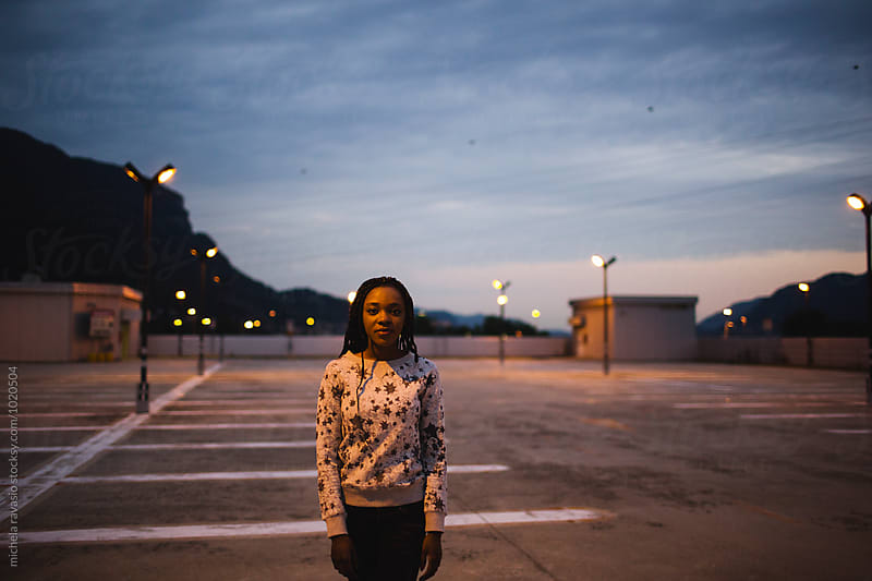 Young woman standing in a roof parking by michela ravasio for Stocksy United