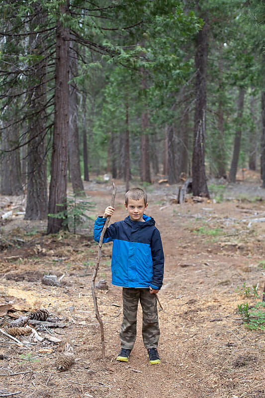 Seven year old boy hiking on the Pacifc Crest Trail by Carleton Photography for Stocksy United