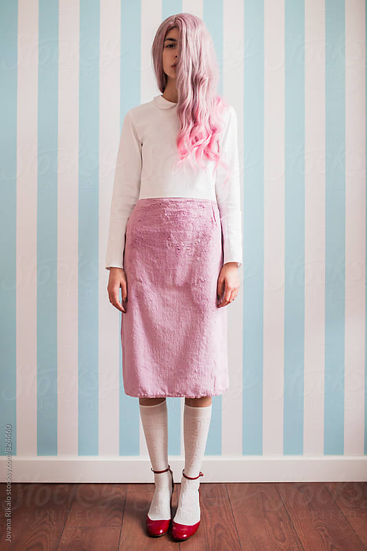 Fashionable young woman with pink hair by Jovana Rikalo for Stocksy United