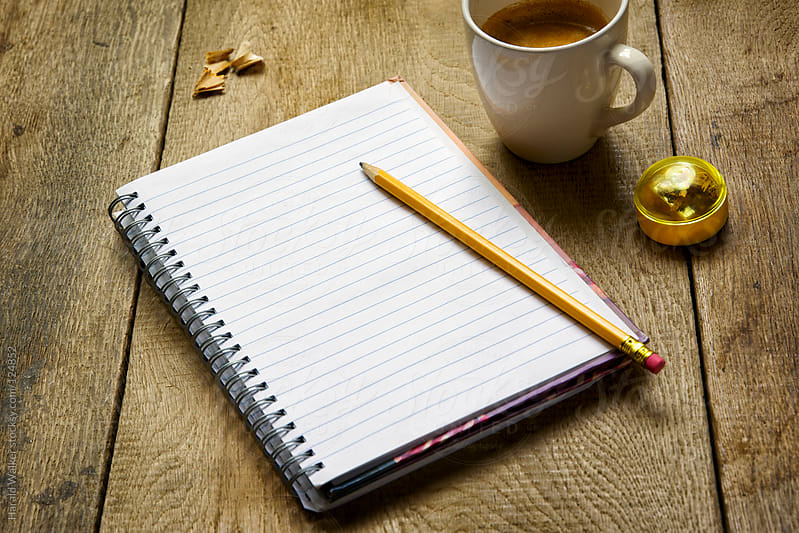 Notebook and coffee by Harald Walker for Stocksy United