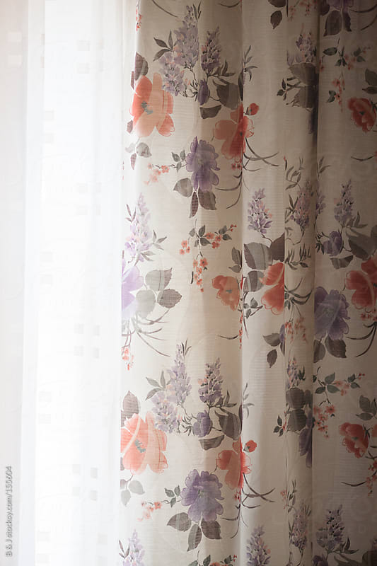Curtains in sunny living room by B & J for Stocksy United