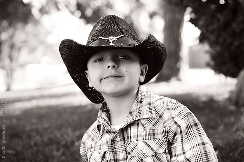 Handsome young  cowboy wearing hat  by Dina Giangregorio for Stocksy United