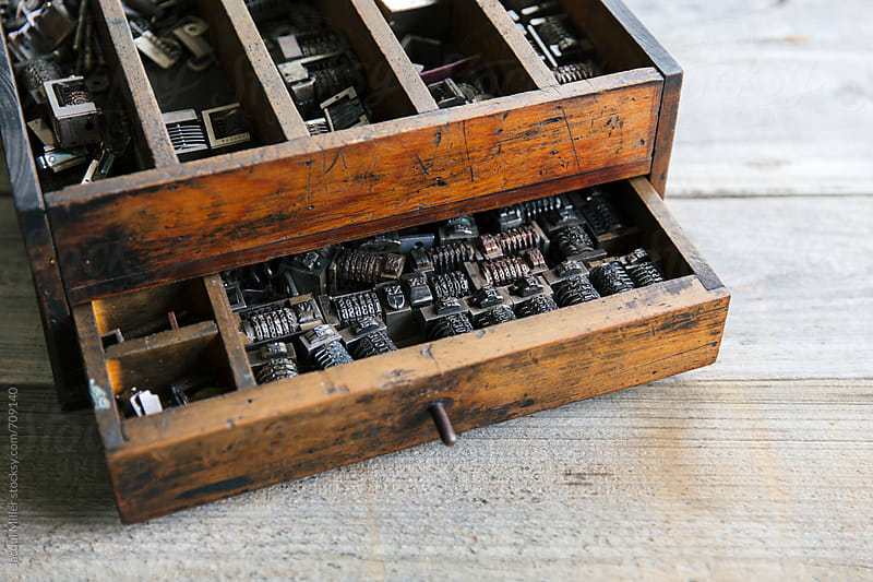 Old wood drawer filled with vintage metal numbering inserts for printer by Jacqui Miller for Stocksy United