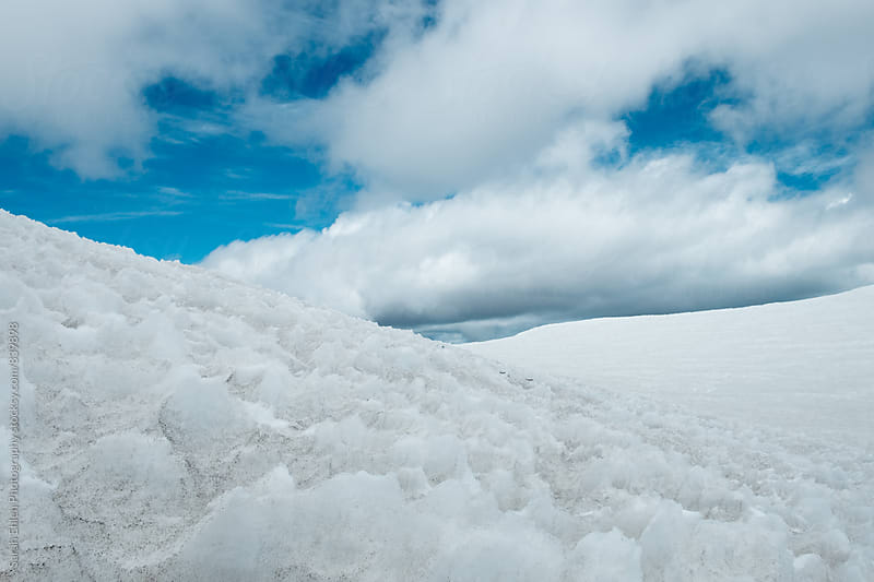 A view of snow and clouds on a mountain. by Sarah Ehlen Photography for Stocksy United