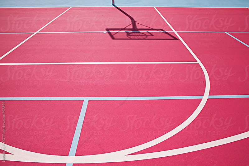 graphic colourful lines on a pink basketball court by Natalie JEFFCOTT for Stocksy United
