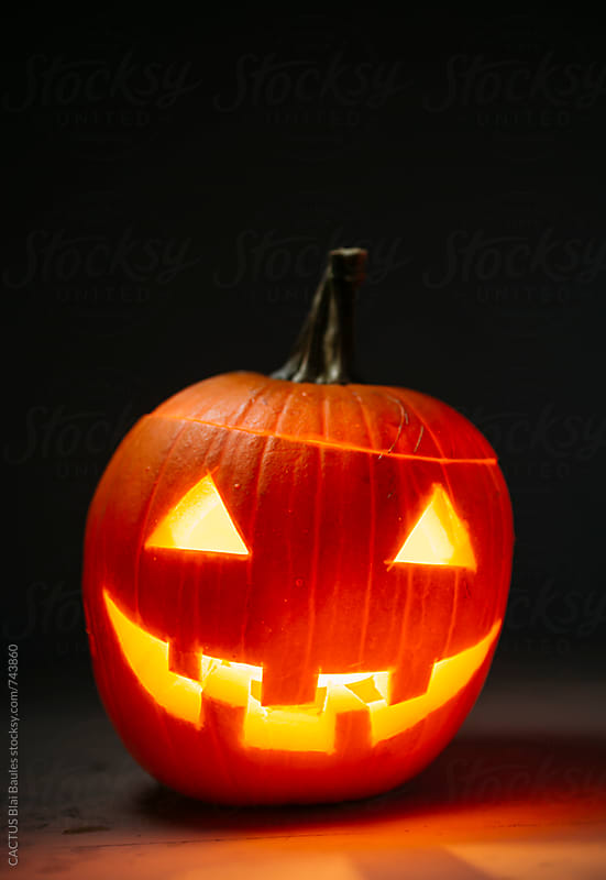 Carved Halloween pumkin  by CACTUS Blai Baules for Stocksy United