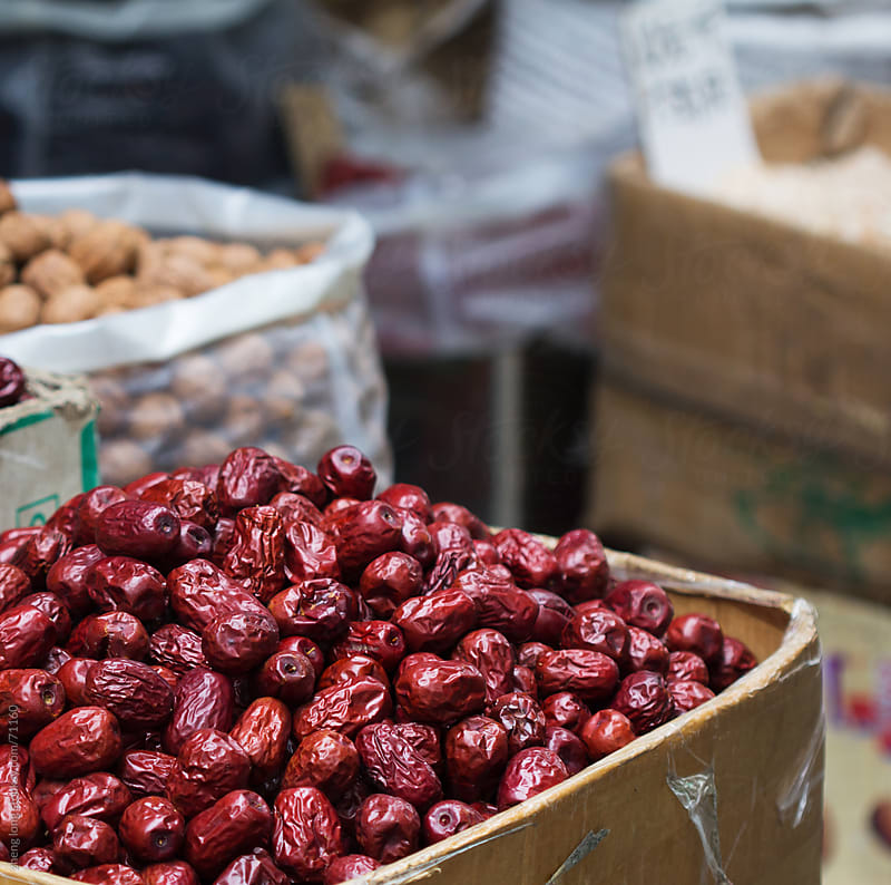 Dried red Chinese dates in market by zheng long for Stocksy United