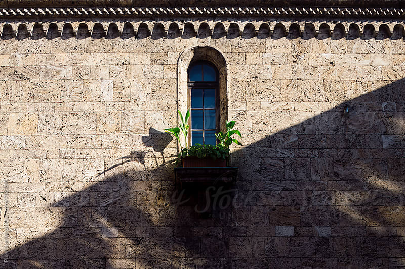 Window on old stone building by Pixel Stories for Stocksy United