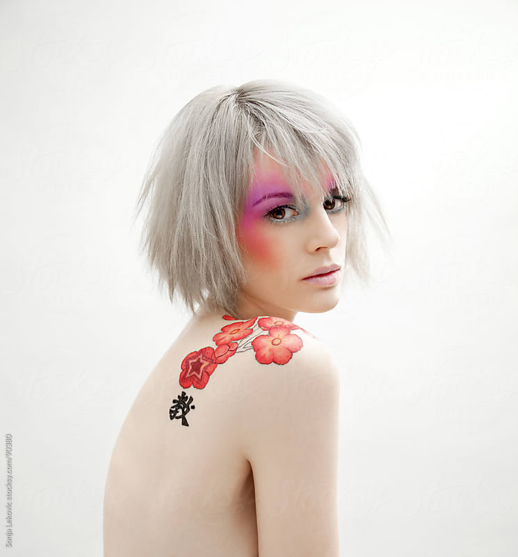 girl with a flower tatoo by Sonja Lekovic for Stocksy United