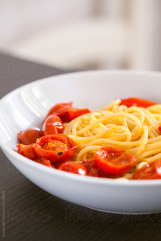 Spaghetti with cherry tomatoes by Davide Illini for Stocksy United