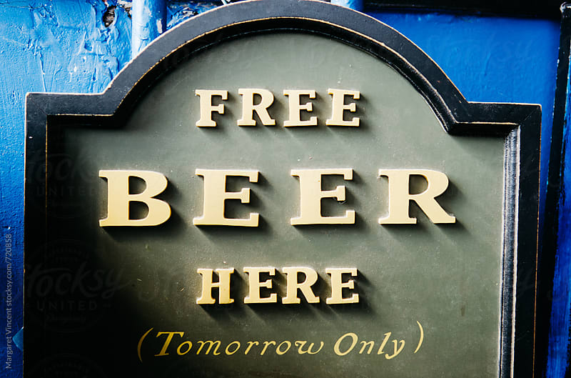 free beer sign by Margaret Vincent for Stocksy United