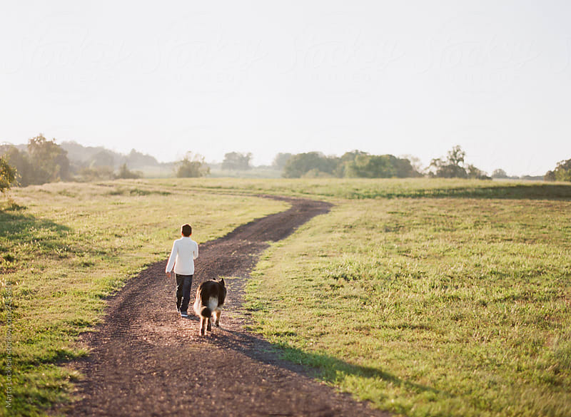 A Boy & His Dog by Marta Locklear for Stocksy United