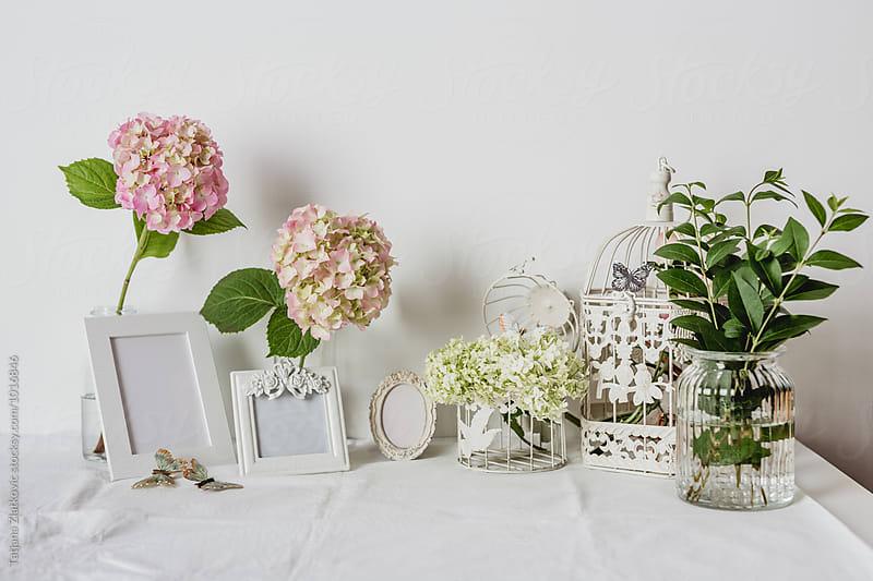 Table decoration with flowers by Tatjana Zlatkovic for Stocksy United