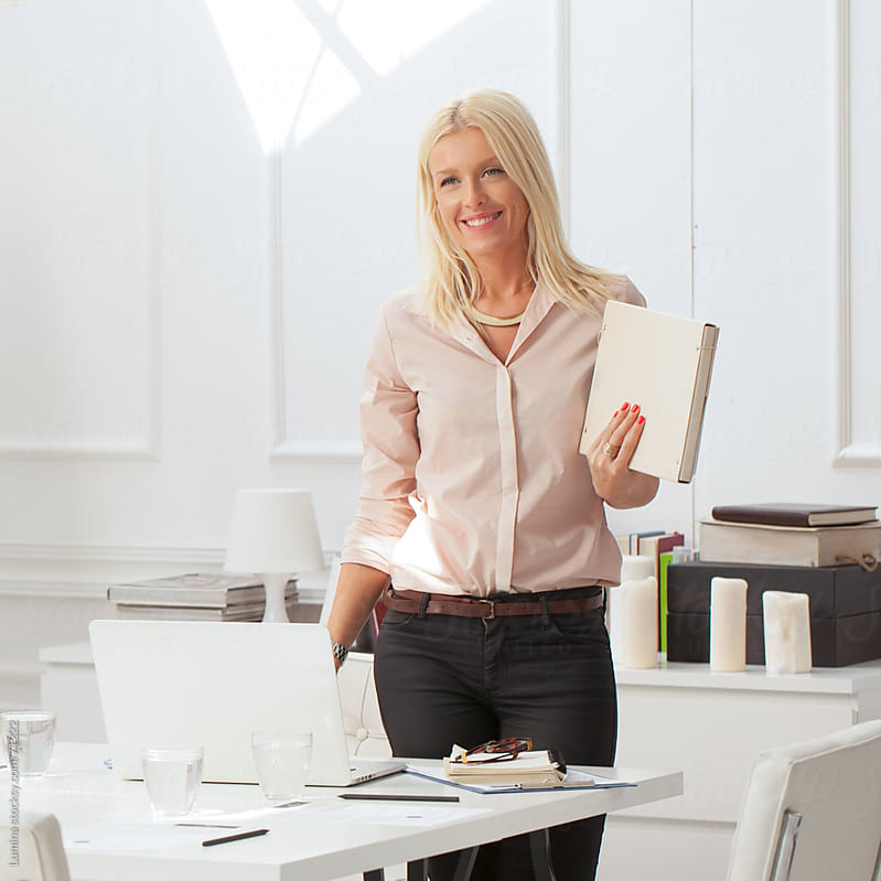 Smiling Businesswoman in Her Office by Lumina for Stocksy United