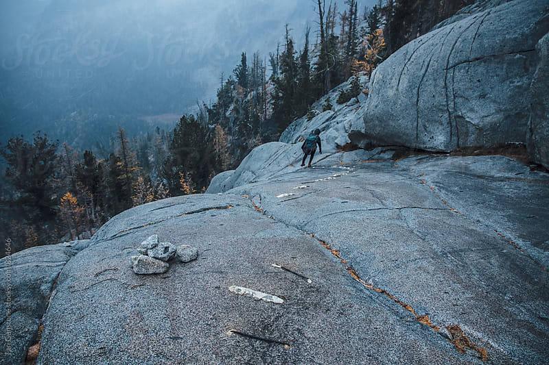 Climbing the granite wall by Tari Gunstone for Stocksy United