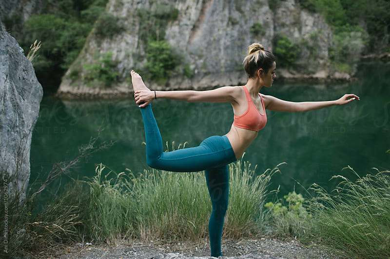 Young fit woman doing yoga  in nature by Ani Dimi for Stocksy United