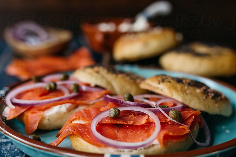 Smoked salmon (lox) on bagels by Gabriel (Gabi) Bucataru for Stocksy United