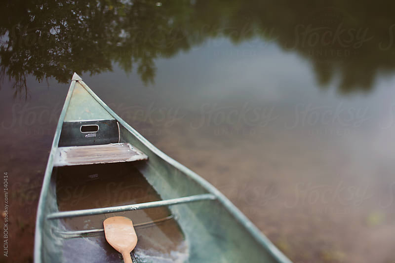 Canoe Filled With Water by ALICIA BOCK for Stocksy United