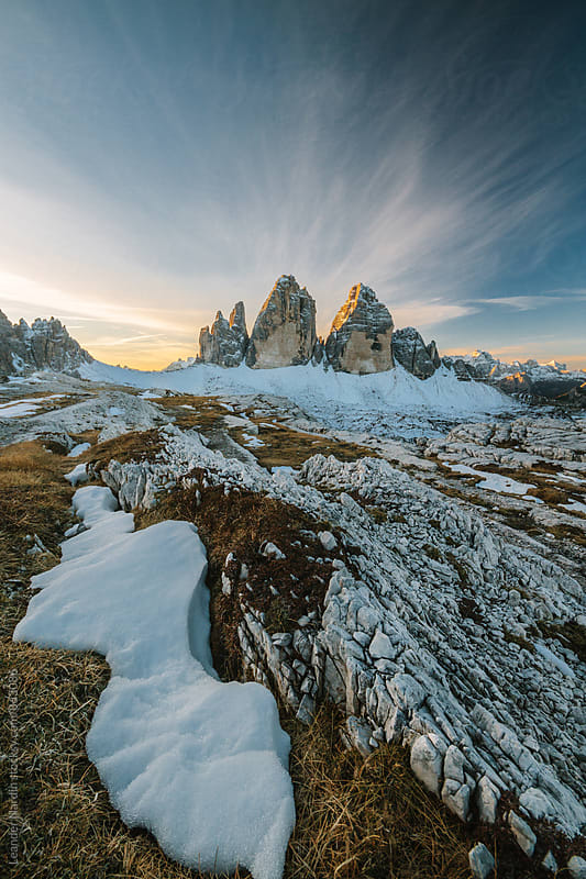 three pinnacles at sunrise in the italian alps by Leander Nardin for Stocksy United