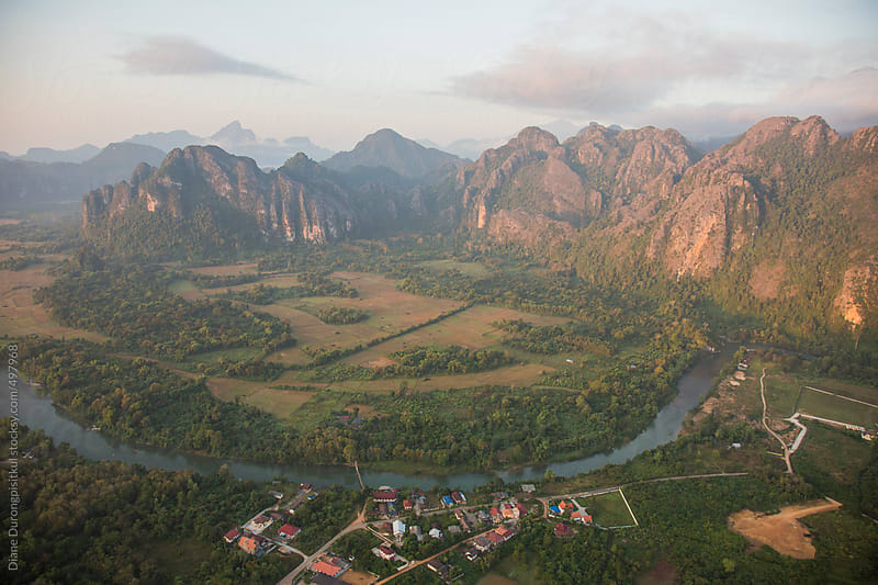 River, Mountains, Village by Diane Durongpisitkul for Stocksy United