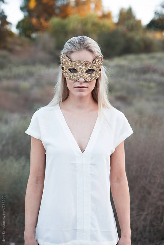 Woman wearing an animal mask by Ivan Solis for Stocksy United