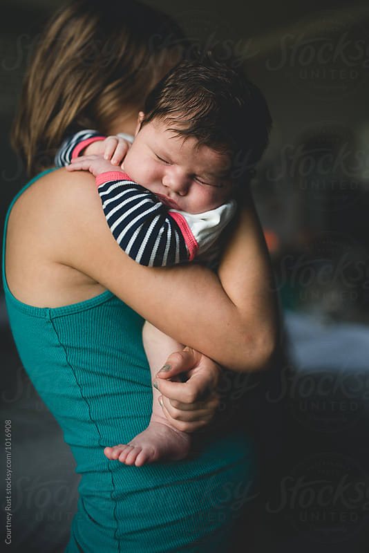 Big sister Holding sweet squish  by Courtney Rust for Stocksy United