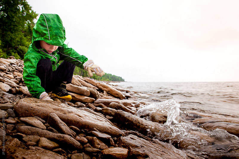 Wet Overcast Rocky Beach by JP Danko for Stocksy United