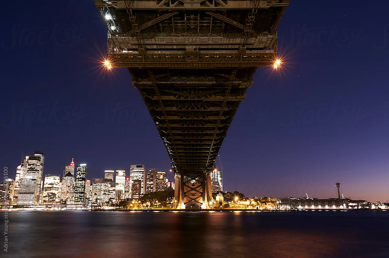 Dusk Under The Sydney Harbour Bridge by Adrian P Young for Stocksy United