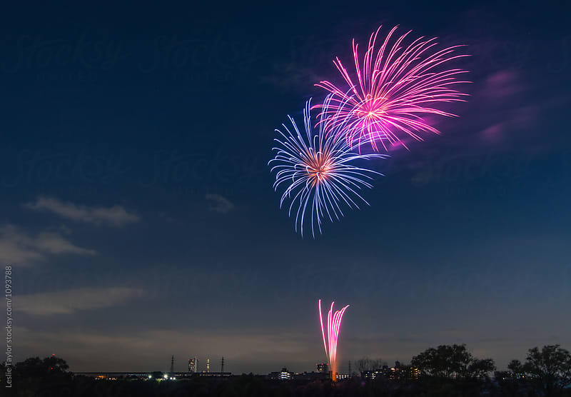 Blue And Pink Fireworks Explode In The Sky by Leslie Taylor for Stocksy United