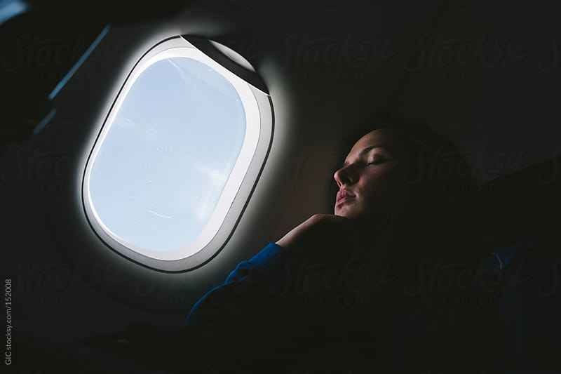 Young woman sleeping on the plane by GIC for Stocksy United