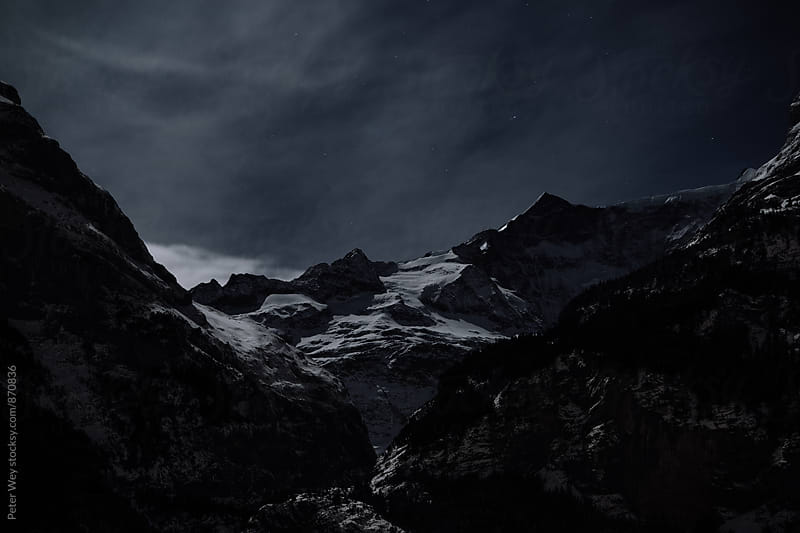 Mountains at full moon by Peter Wey for Stocksy United