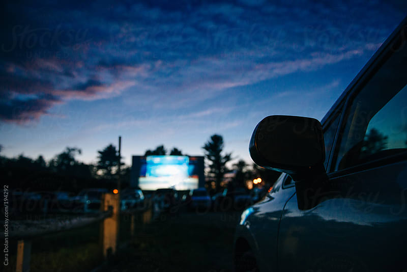 Night falls at the drive-in movie theatre by Cara Dolan for Stocksy United