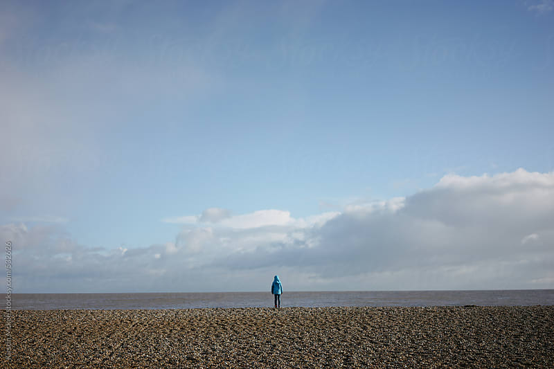 Boy looking at the sea in winter by Kirstin Mckee for Stocksy United