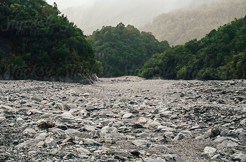 Dried out river in New Zealand by Dominique Chapman for Stocksy United